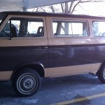 Brown and tan two-tone T3 van in parking garage.