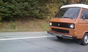 Orange van barreling down roadway