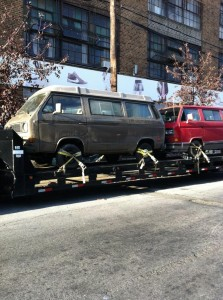 Brown and red vans on car carrier