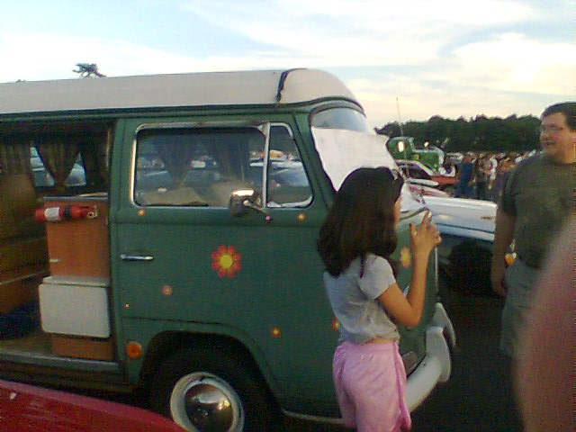 Green van in parking lot at car show