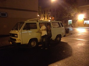 White t3 van parked on rainy street