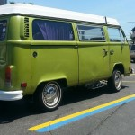 green t2 van in autozone parking lot, rear view