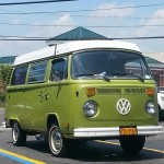 green t2 van in autozone parking lot, front view