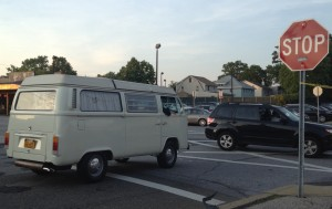 white t2 van driving on the street