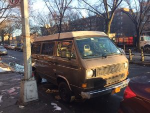Brown T3 van parked on street during day, front view