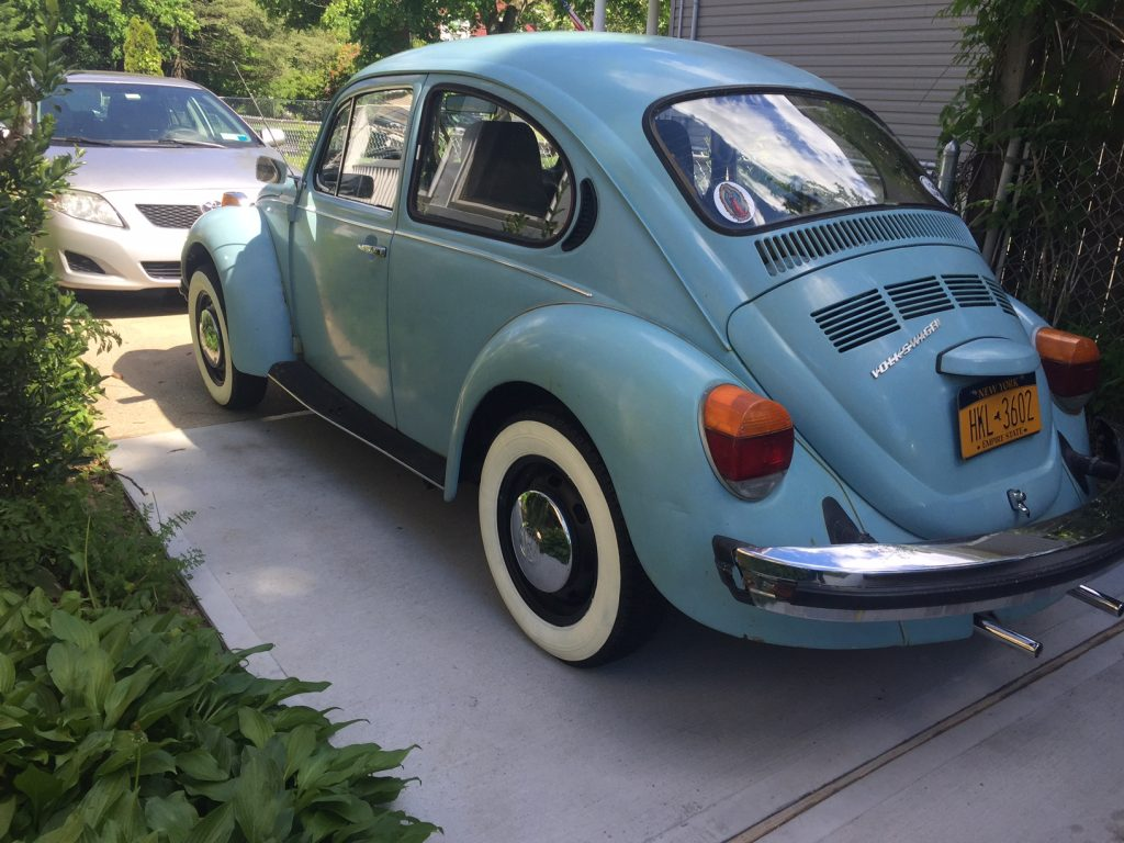 Blue VW Beetle with wide whitewalls