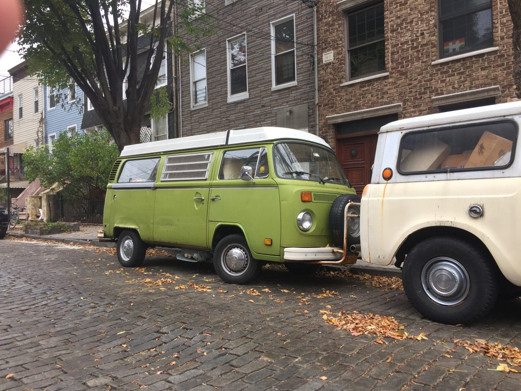 green bay window van parked on cobblestone street