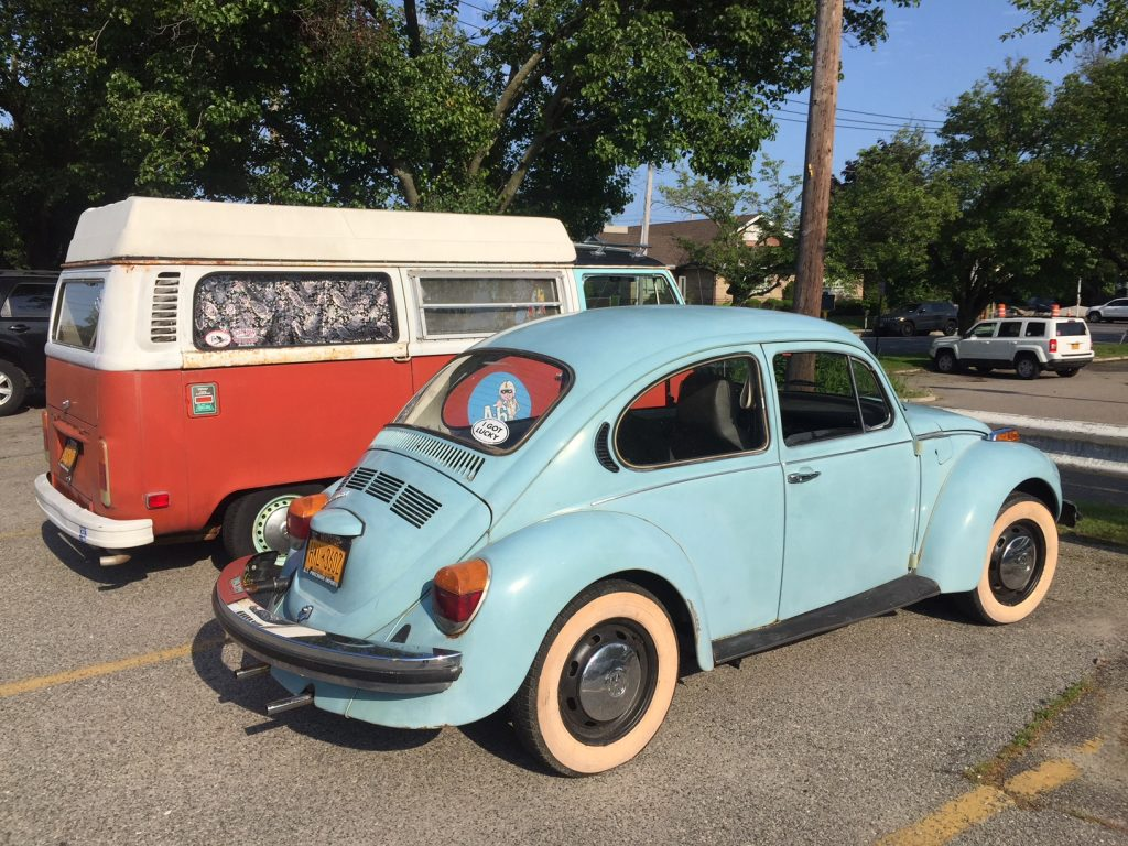 Blue beetle, red van, parked in lot