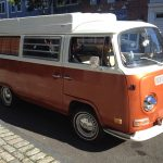 orange camper van street parked